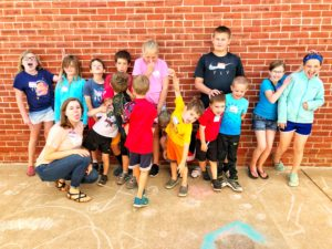 Kids showing off their silly faces during Bricker-Price Blocks local and affordable summer camps called Kid's Club.
